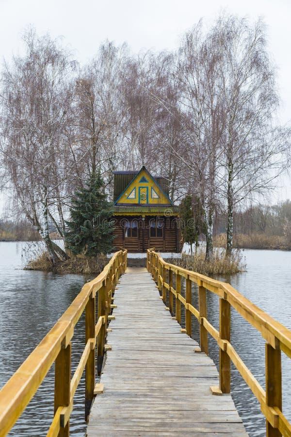 在湖的神仙的木渔夫的小屋 库存照片