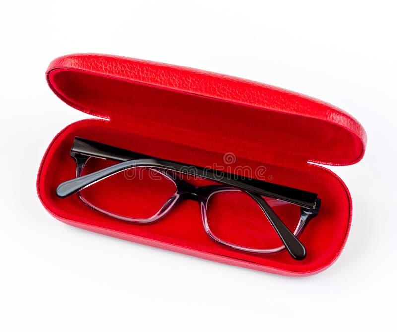 在红色盒的玻璃在白色背景 免版税库存照片