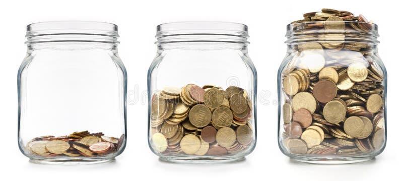 在玻璃的增长的硬币 图库摄影