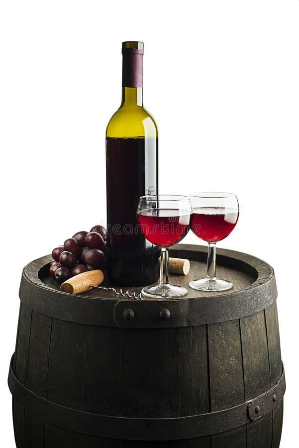 在白色和玻璃隔绝的红葡萄酒瓶 库存照片