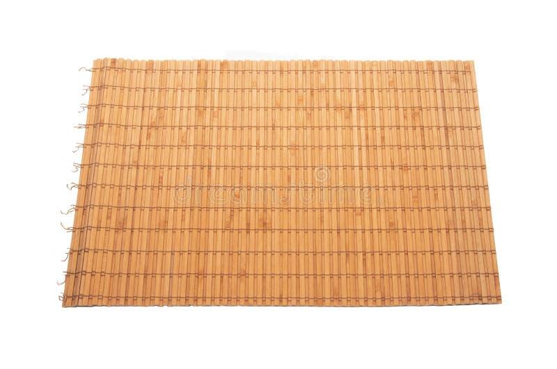 在白色被隔绝的背景的竹餐巾 库存图片