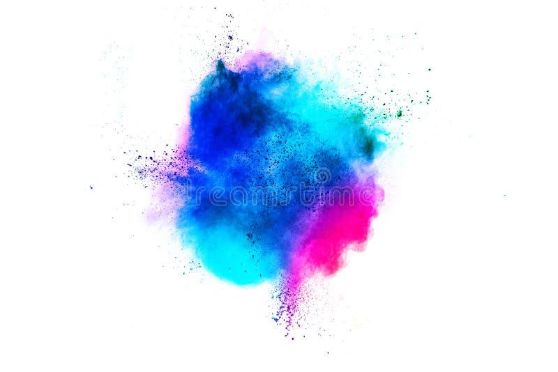 在白色背景的多颜色粉末爆炸 被发射的五颜六色微尘飞溅 库存照片