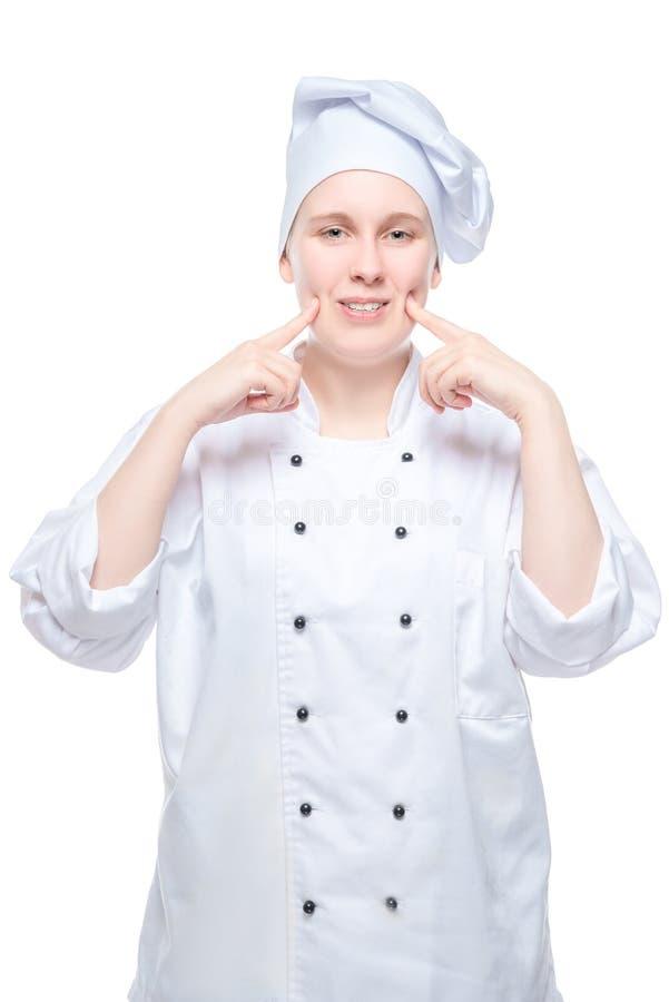在白色背景的女性厨师射击 免版税库存图片