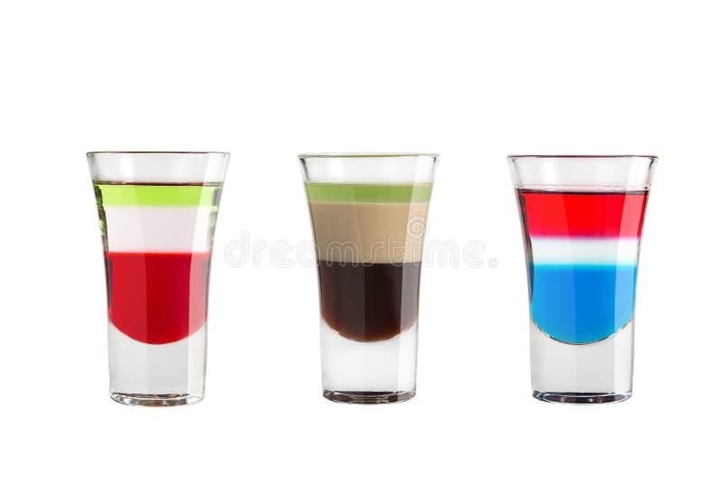 在白色背景的酒精射击 三五颜六色的射击 免版税库存图片