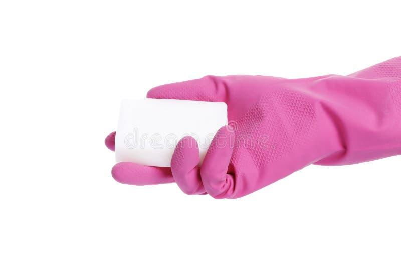 在白色背景隔绝的一副桃红色手套的肥皂 库存图片