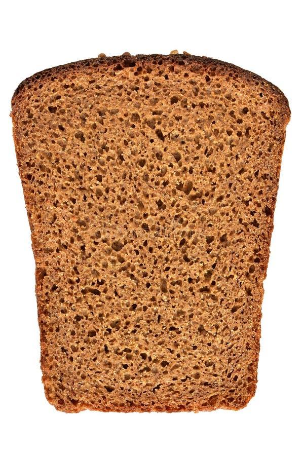 在白色背景隔绝的切的黑麦面包 库存照片