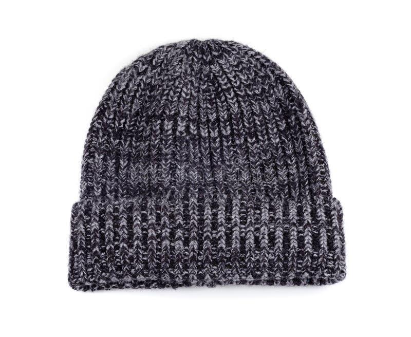 在白色背景隔绝的冷天的羊毛编织帽子 库存照片