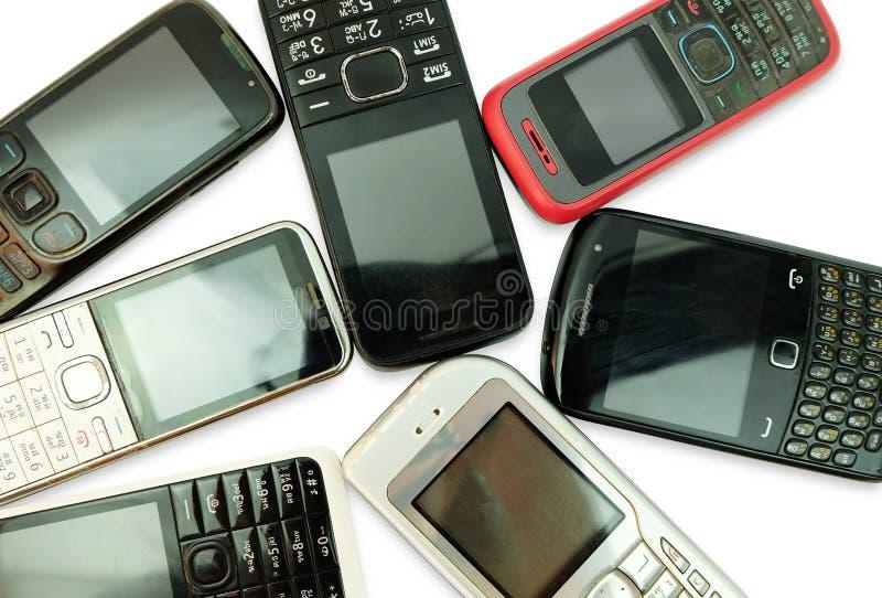 在白色背景隔绝的老手机 库存照片