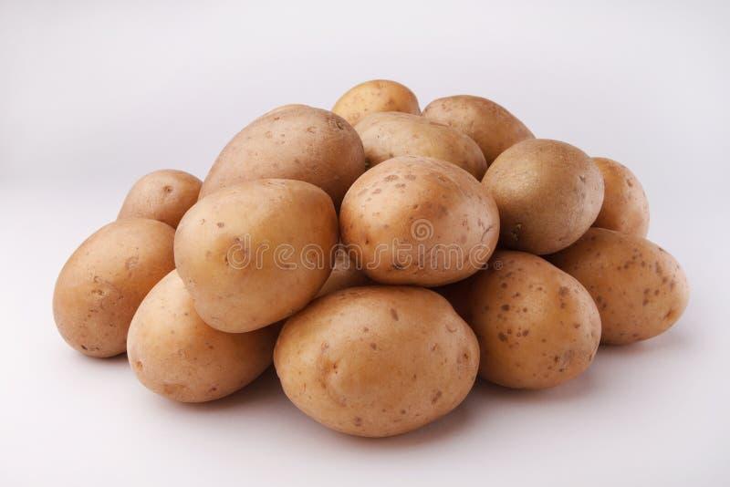 在白色backgroun的一些土豆 免版税库存图片