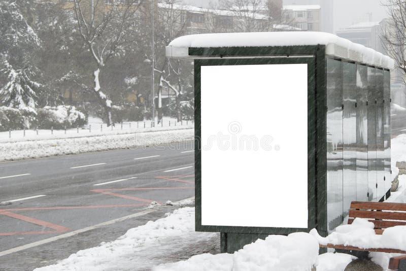 在街道上的广告牌在冬天 免版税图库摄影