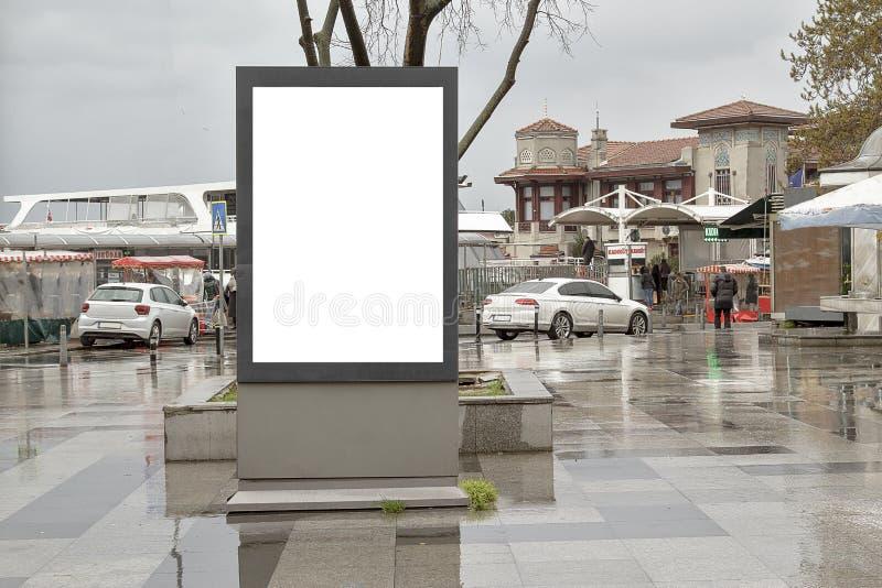 在街道上的广告牌在秋天 免版税图库摄影