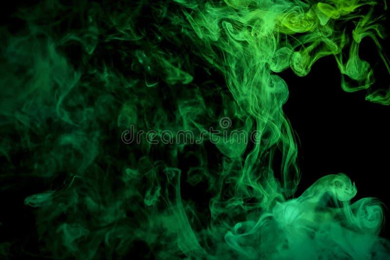 在黑被隔绝的背景的抽象派彩色烟幕 库存照片