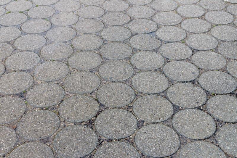 圆的灰色街道瓦片,背景,纹理 库存照片