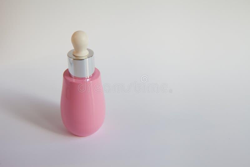 化妆用品的桃红色瓶 库存图片