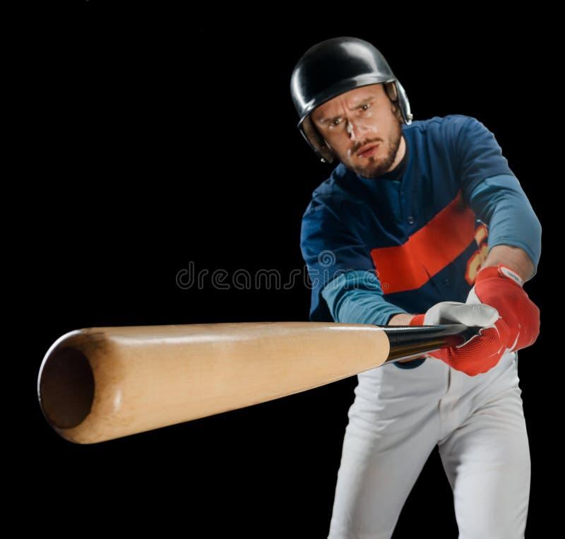 击球手的强有力的摇摆 库存照片