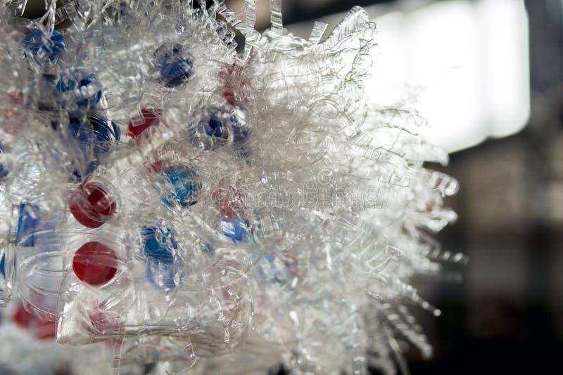 关闭有红色和蓝色焰晕的被切的塑料瓶 免版税库存照片