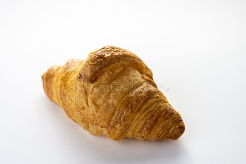 Świeży piec croissant odizolowywający na białym tle obrazy royalty free