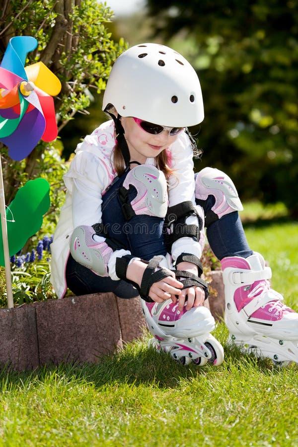 åka skridskor för flicka arkivfoto