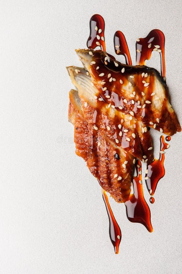 Ålar som kryddas med sesam royaltyfri bild