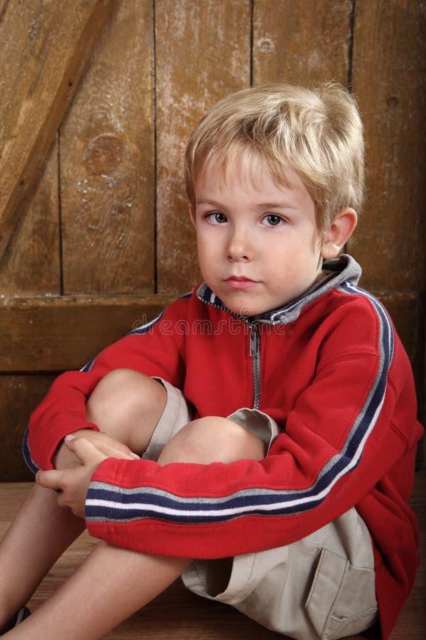ålderpojkeförträning royaltyfri foto