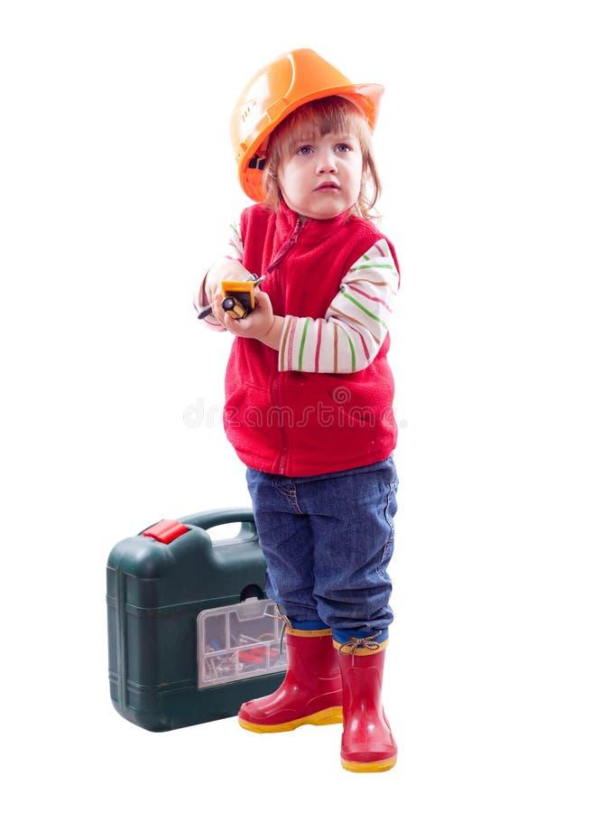 2 år barn i hardhat med hjälpmedel royaltyfri bild