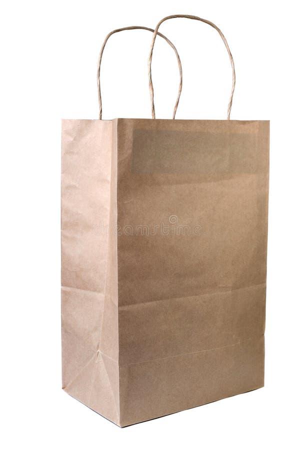 Återanvänd pappers- shoppingpåse på vit bakgrund royaltyfri fotografi