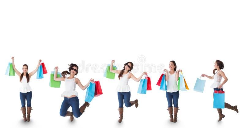 Åtskillig bild av kvinnan med shoppingpåsar mot vit bakgrund arkivfoton