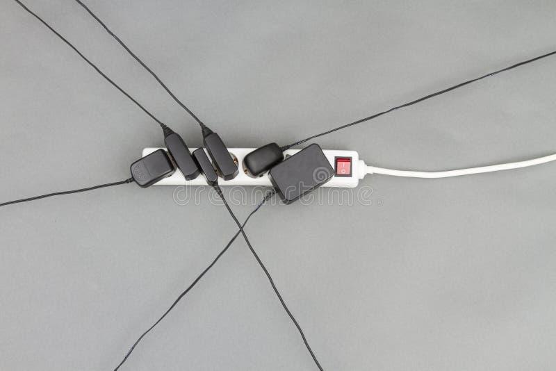 Åtskillig stickkontakt med strömtillförsel arkivbilder