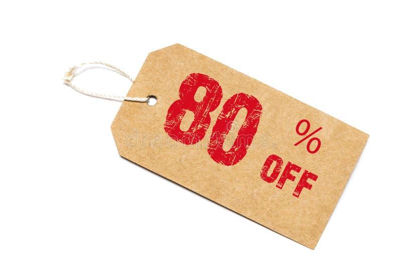 Åttio procent av rabatt - en pappers- prislapp på den vita backgroen royaltyfri fotografi