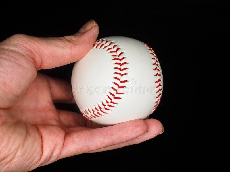 棒球在手中 免版税库存图片