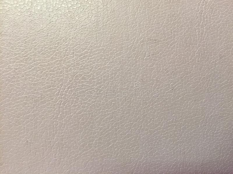 浅灰色的背景颜色,从乙烯基皮革的纹理 免版税库存图片