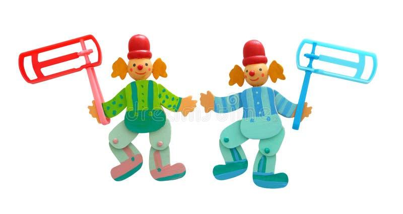 木五颜六色的小丑和塑料发出大声音的人 库存照片