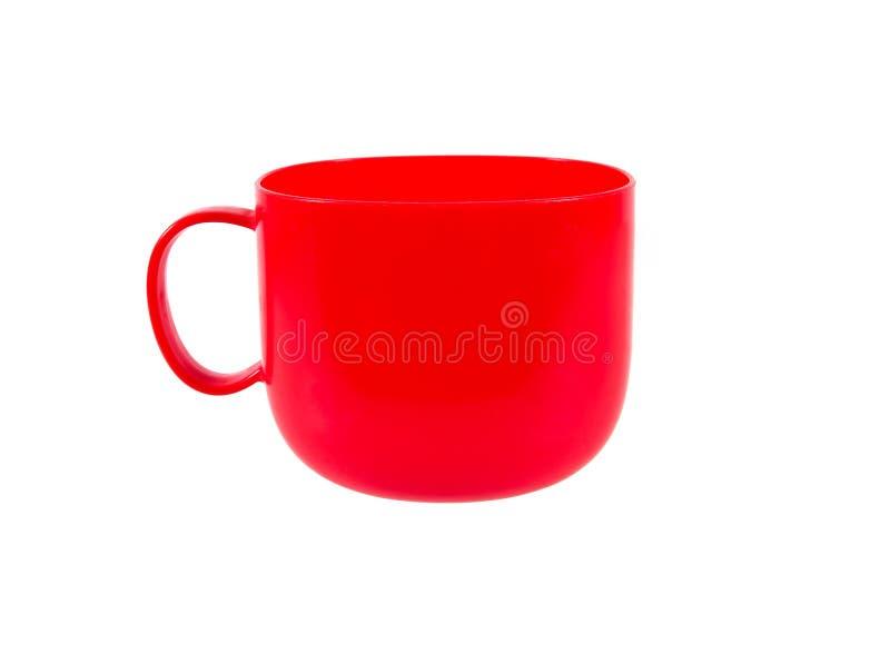 有在白色背景隔绝的把柄的红色塑料杯子 库存照片