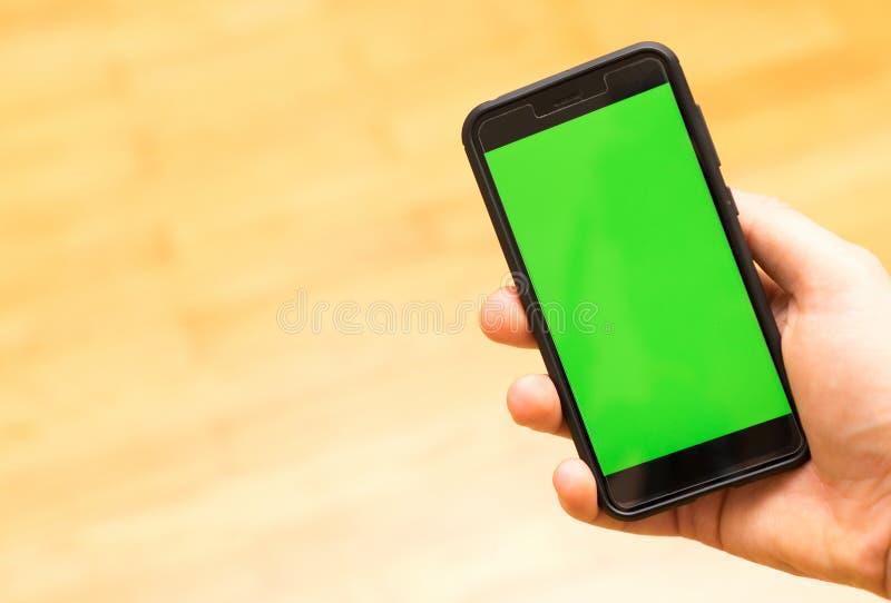 有智能手机的男性手 库存照片