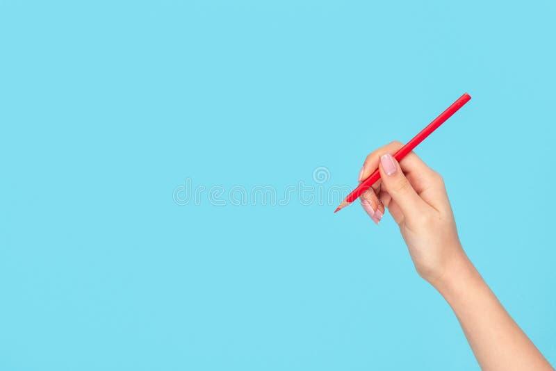 有红色上色铅笔的女孩 库存图片