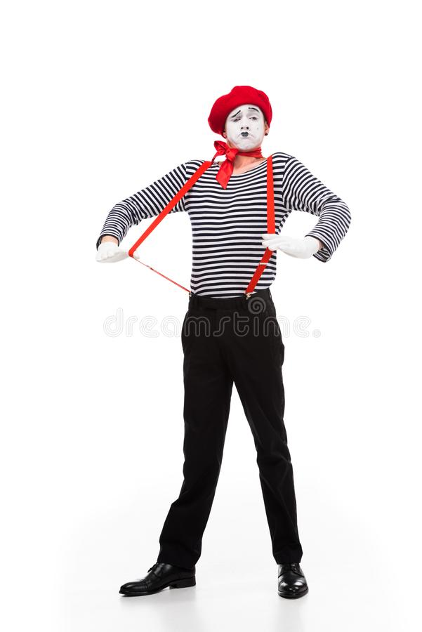 有红色悬挂装置的做鬼脸的笑剧 免版税库存图片
