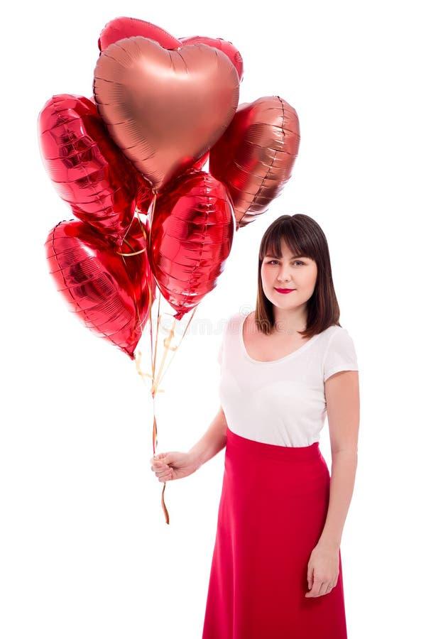 情人节或生日概念-有在白色隔绝的红色气球的妇女 免版税库存照片
