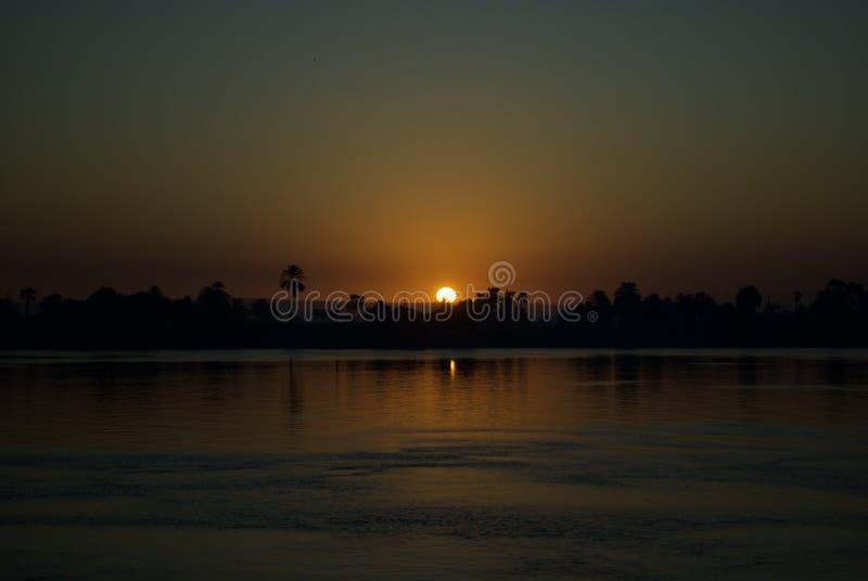日落在尼罗河,埃及 免版税库存照片
