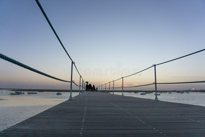 日落剪影集中了法鲁葡萄牙 图库摄影
