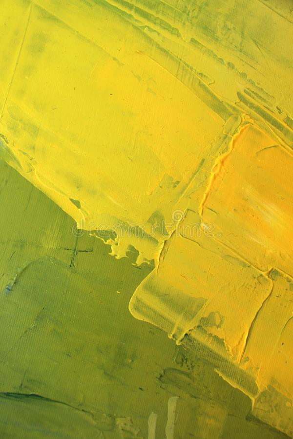 手拉的油画 抽象黄色艺术背景 在画布的油画 颜色纹理 艺术品的片段 绘画的技巧 库存图片