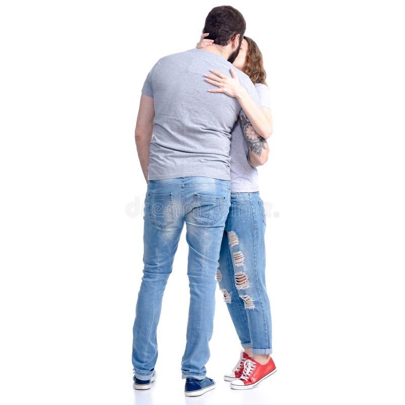 拥抱亲吻的爱的男人和妇女便衣 免版税库存照片