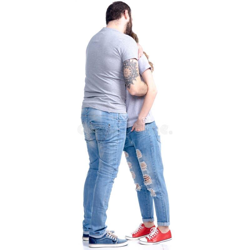 拥抱妇女的人在进攻争吵以后 免版税图库摄影