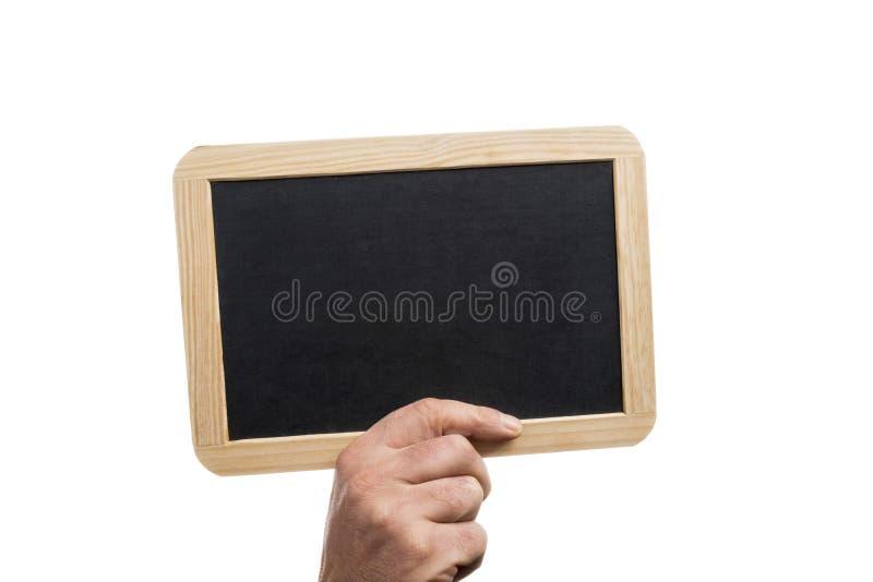 拿着与木制框架的播种的手一个空白石板板,隔绝在白色背景 图库摄影