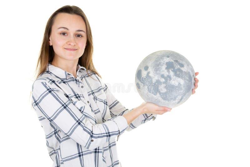 拿着在白色背景的妇女发光的球形月亮 免版税库存图片