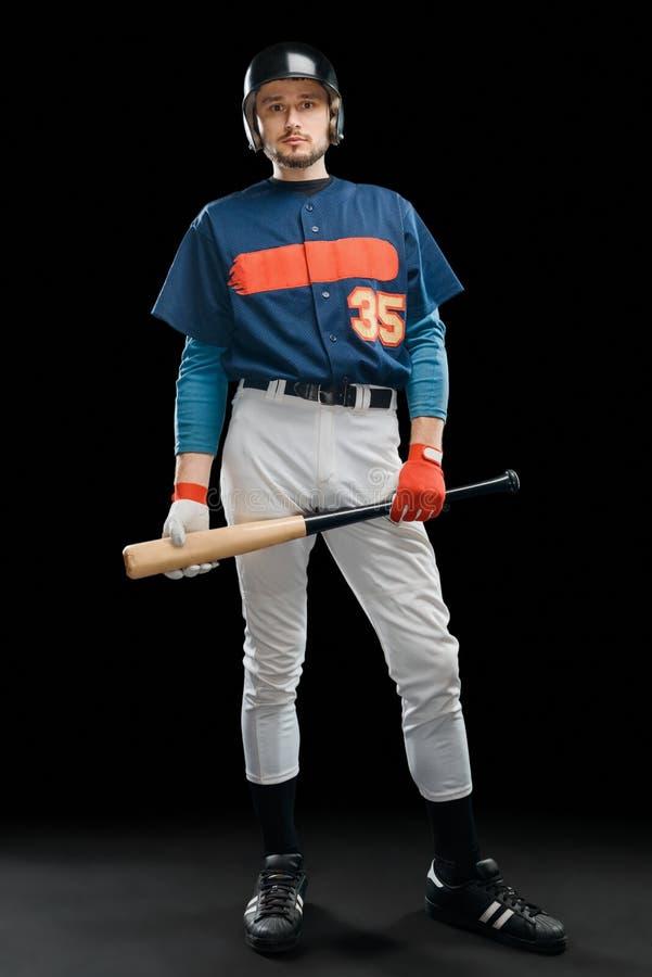 拿着棒球棒的击球手 库存照片