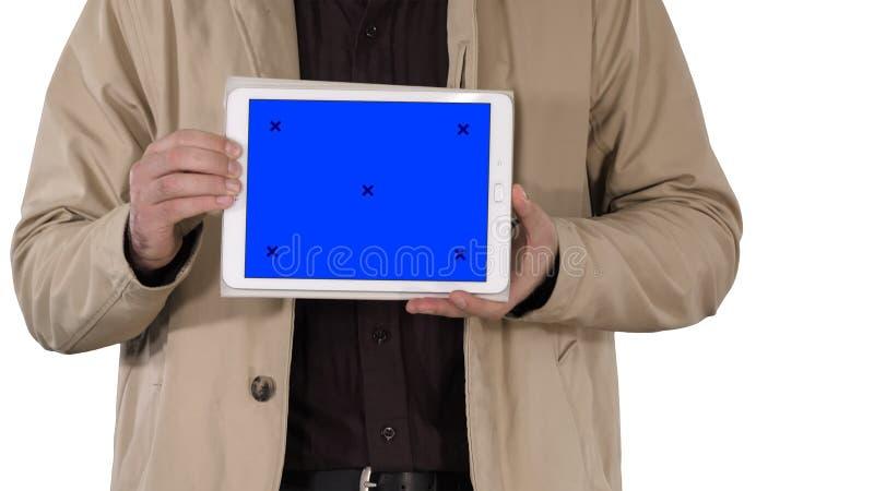 拿着有蓝色屏幕大模型的男性手片剂在白色背景 库存照片