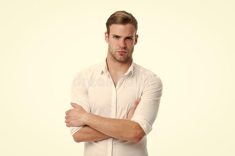 新和确信 供以人员穿着考究的白色典雅的衬衣被隔绝的白色背景 强壮男子确信准备工作办公室 库存图片