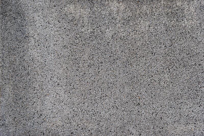 灰色具体有石渣墙壁背景 免版税库存图片