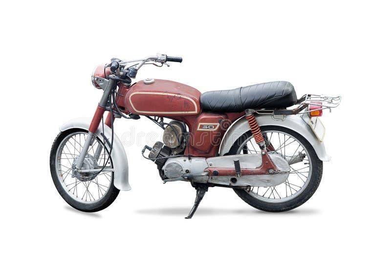 红色生锈的老摩托车 免版税库存图片