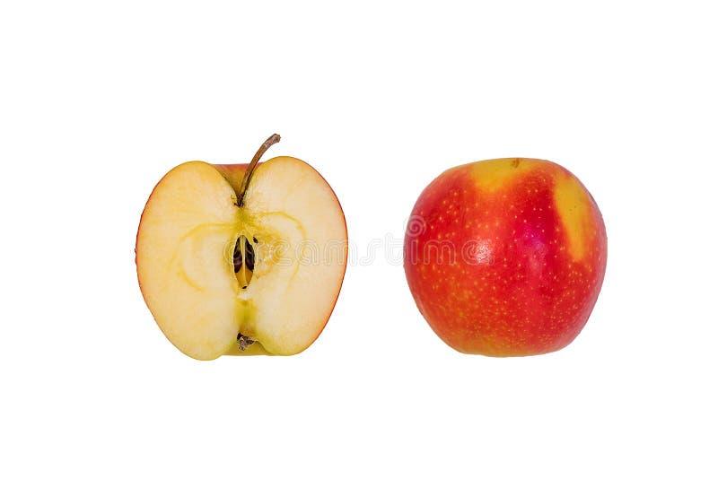 红色苹果计算机的两个一半在白色背景的 库存照片